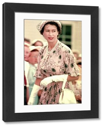 A colour image of Queen Elizabeth II on her visit to Australia in 1954. The Queen accessorizes her pink dress with white gloves and handbag. Children can be seen in the background, although their faces are blurred