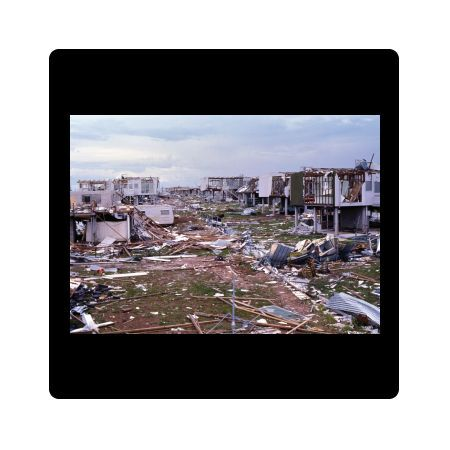 A colour image of the devastation of Darwin in the early days following the strike of Cyclone Tracy, Christmas Day 1974. Houses have been gutted over have collapsed due to the strength of the cyclone that hit on Christmas Day