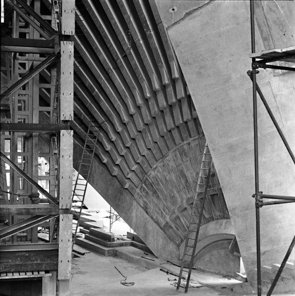 A black and white photograph of the construction of the Sydney Opera House