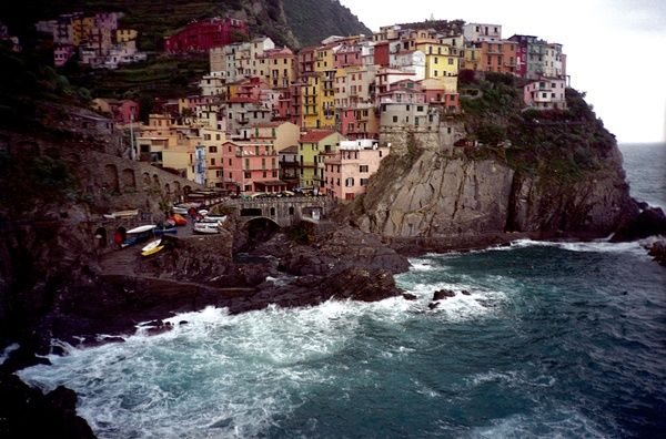 Coastal town of Manarola, Italy. One of the 5 small fishing villages that form Cinque Terre on the Italian Riviera coastline