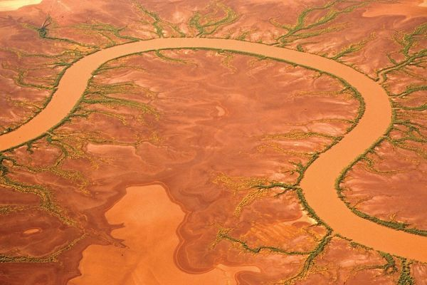 A colour image of an aerial view of river and mudflats