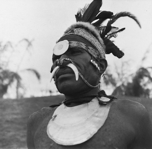 Road to the Clouds. Papua New Guinean man in traditional dress