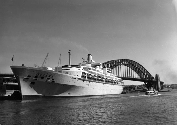 Cruise ship SS Oriana docked at Circular Quay in Sydney Harbour. The cruise ship was eventually turned into a floating museum and hotel in Japan before being dismantled in 2005. The image also shows the Sydney Harbour Bridge in the background