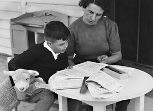 Boy studying with lamb. School in the Mailbox, 1946.