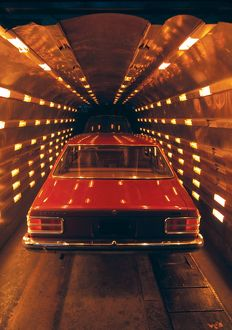 Red car in tunnel. Australia Game, 1978.