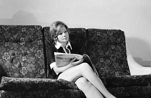 Woman seated on couch. Taxi, 1972.