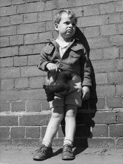 Young boy and his stuffed toy. Our policemen, 1952.