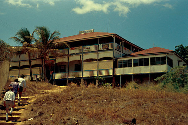 A colour image of the Grand Hotel, Thursday Island, which has since burnt down and been rebuilt. The hotel was a famous watering hole and was visited by the writer William Somerset Maugham. The Collis Bakery was located to the right of the image