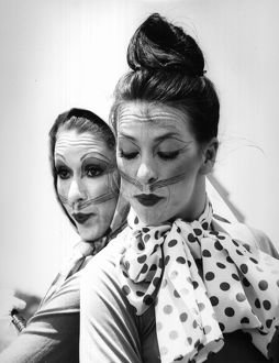 A black and white image of two female actors in cat makeup
