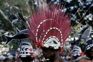 pacific islands/close male performer wearing elaborate red