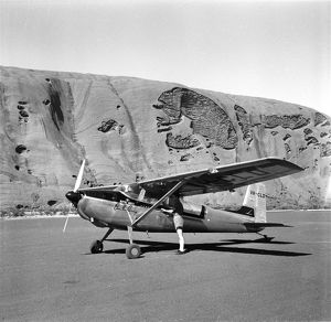 Pilot arriving in small plane near the foot of Uluru. Appointment with Alice, 1962