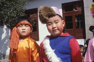 people/primary age chinese children wearing colourful