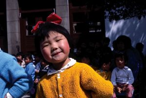people/young chinese girl yellow knit cardigan smiling