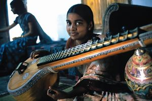 india/young girl string instrument asian neighbours